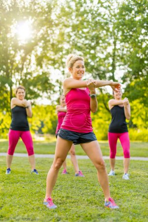 group of women streching before a run