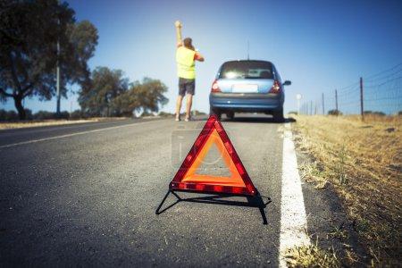 Emergency triangle in a breakdown car scene.