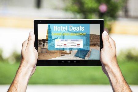 Hotel Deals on tablet. Web template design.