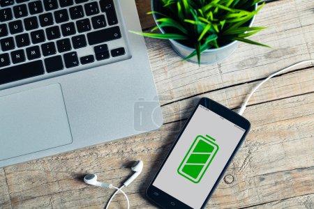 Full battery mobile phone in a desktop.