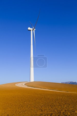 Windmill in a brown countryside.