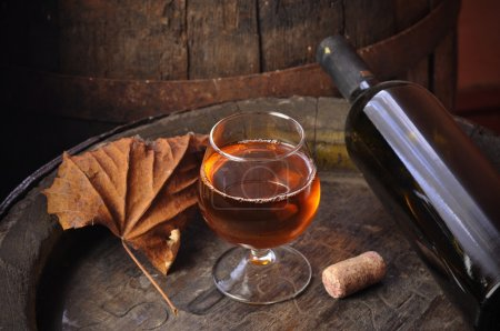 Photo for Cuban cigars and cognac in glass, bottles and barrel on a wooden background - Royalty Free Image