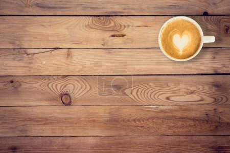 Photo for Coffee on wood table texture with space for text - Royalty Free Image
