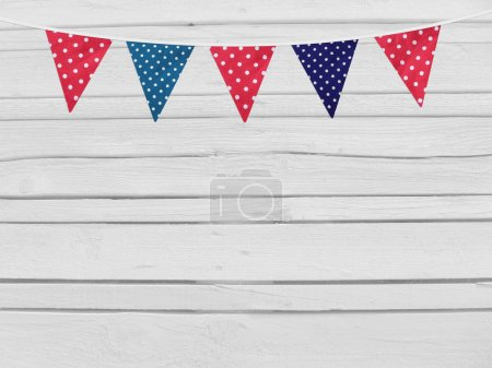 Birthday, baby shower mockup scene. Party flags decoration. Wooden background. Empty space for your text, top view.