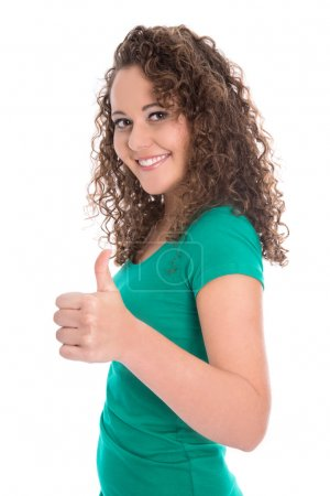 Successful isolated teenager in green with thumbs up.