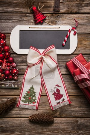 Christmas greeting card with a sign for an text in red.