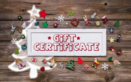 Wooden colorful christmas sign with text and decoration: gift ce