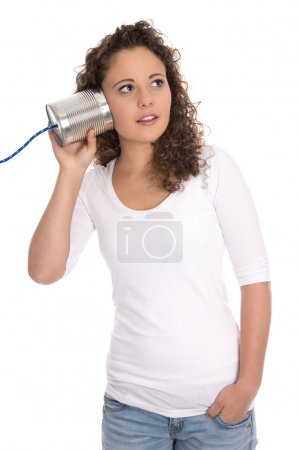 Isolated serious woman listening on tin can phone for news or ch