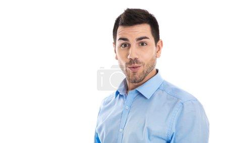 Foto de Retrato de un empresario divertido aislado preguntándose y sorprendido sobre algo . - Imagen libre de derechos