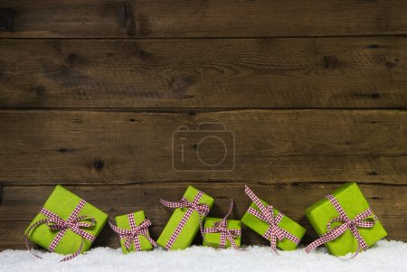Apple green christmas presents on wooden background for a gift c