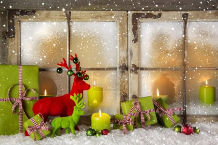 Festive christmas window decoration in green and red with presen