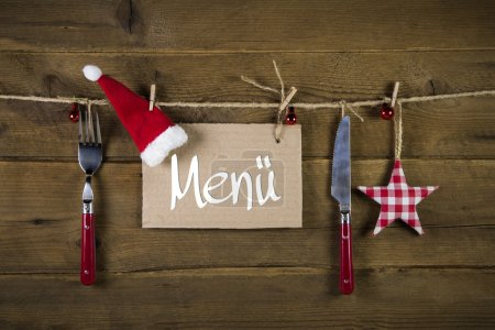 Christmas menu card for restaurants with knife and fork on woode