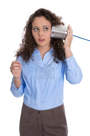 Photo pour Isolated young business woman with tin can phone serious and stunned. - image libre de droit