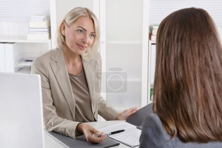 Photo for Mature businesswoman in a job interview with a young woman. - Royalty Free Image