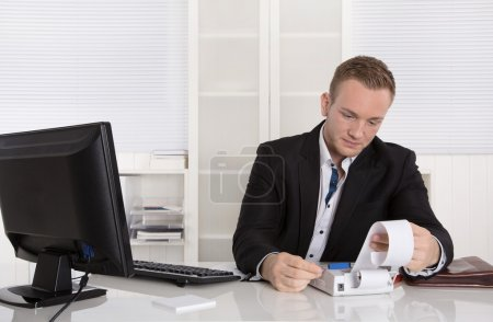 Occupation controller: young businessman looking frustrated at p