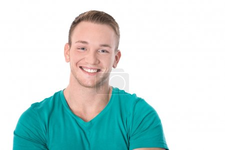 Happy isolated young blond man in green shirt smiling: white tee