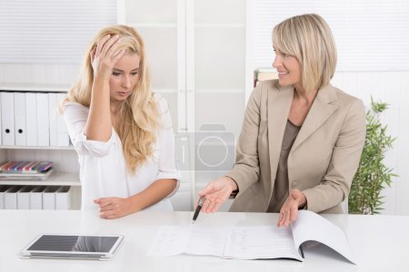 Young female trainee had made an error at work and her boss crit