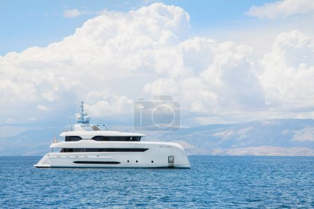 Modern white mega yacht in the blue sea. Rich people on holidays
