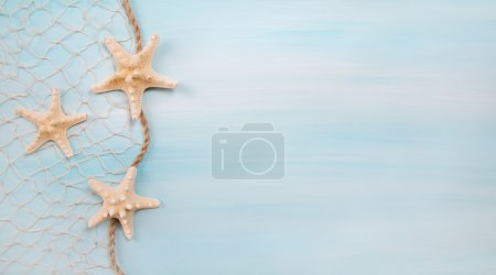 Photo for Blue turquoise background with starfishes or shells for maritime decoration. - Royalty Free Image