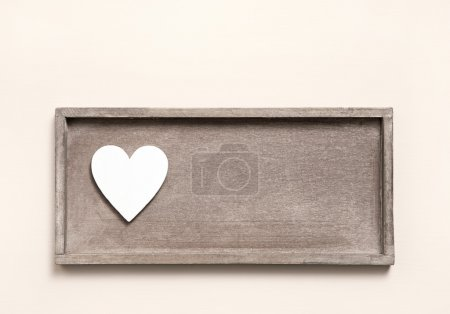 Photo for One wooden heart on a sign for a greeting card. Shabby chic style for valentines or mother's day. - Royalty Free Image