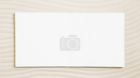 White sign on a beige sand background.