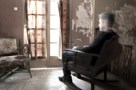 Man sitting on rocking chair