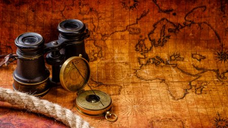 Photo for Old vintage retro compass and binoculars on ancient world map. Vintage still life. Travel geography navigation concept background. - Royalty Free Image