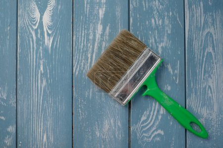 Photo for Paint brush on a blue wooden table - Royalty Free Image