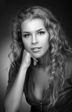 Photo for Simple black and white portrait of a beautiful young blonde with long curly hair. - Royalty Free Image