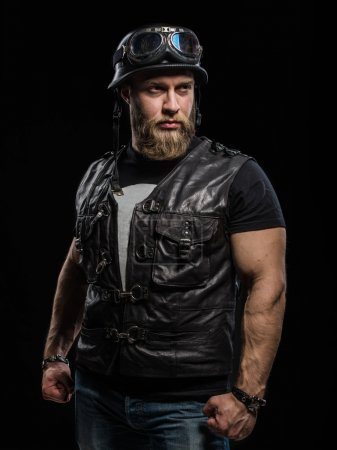 Portrait Handsome Bearded Biker Man in Leather Jacket and Helmet