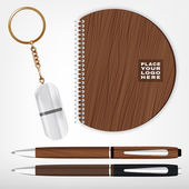 Vector illustration of a wooden and metal souvenirs with a rings for a key notebook and pens Isolated on a white background Ideal template for branding identity guidelines and promo campaigns