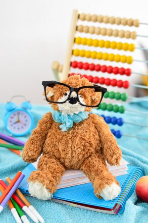School supplies. Teddy bear with glasses