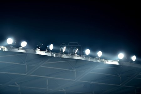 Photo for Night scene shot with sport arena floodlights seen through fog - Royalty Free Image