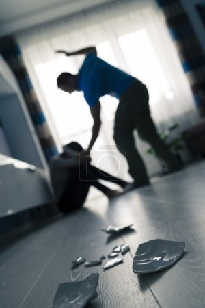 Photo for Man beating the woman on the floor - Royalty Free Image