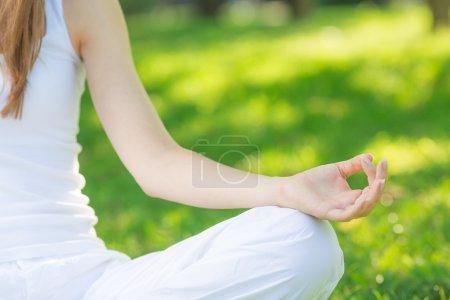 Woman meditating in lotus position.