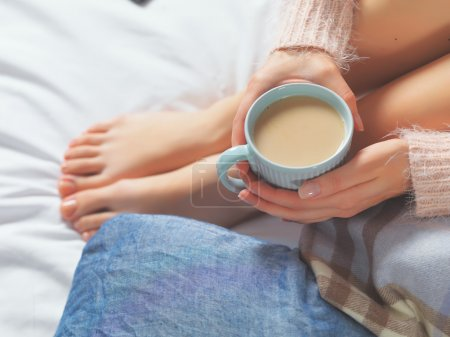 Woman relaxing at cozy home atmosphere