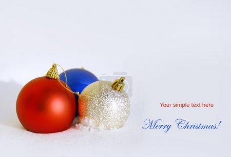 Christmas holiday background with baubles and snow