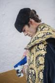 Spainish bullfighter Jose Tomas putting itself the walk cape in