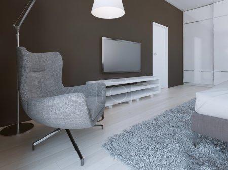Soft grey armchair in minimalist bedroom
