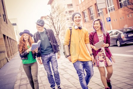 Photo for Group of young students walking outdoors in a college campus - Young people portrait, concepts about youth, modern technologies, lifestyle and teens - Royalty Free Image