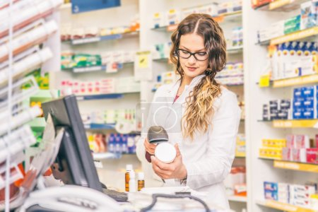 Pharmacist scanning price
