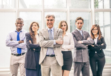 Photo for Smiling multiracial business team standing and looking confident at camera - Group of business people in the office, concepts about teamwork and business - Royalty Free Image