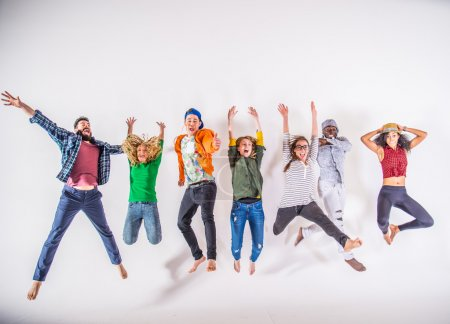 Photo for Multi-ethnic group of friends jumping on white background, studio shot - Royalty Free Image