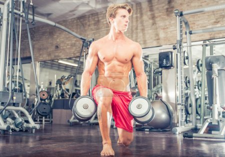 Photo for Bodybuilder training hard in the gym. - Royalty Free Image