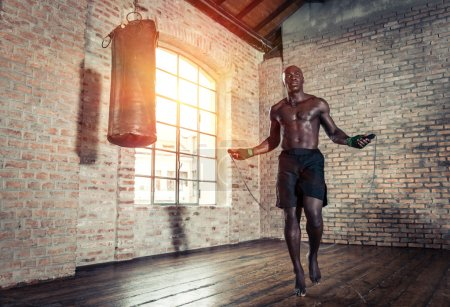 Photo for Black fighter training hard in his gym - Royalty Free Image