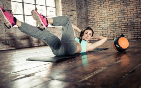 woman making abs training in gym