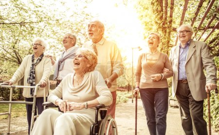 Photo for Group of old people walking outdoor - Royalty Free Image
