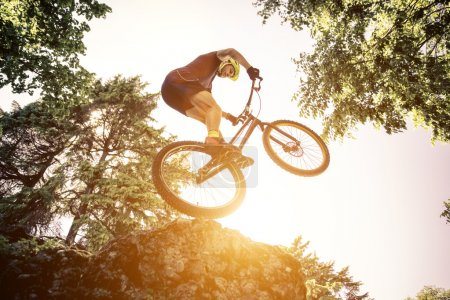 Extreme jump with a trial bycicle. concept about downhill