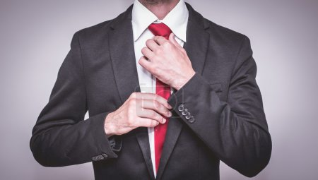 well dressed business man with red tie