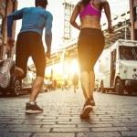 Back view of Couple running in Brooklyin. Urban ru...